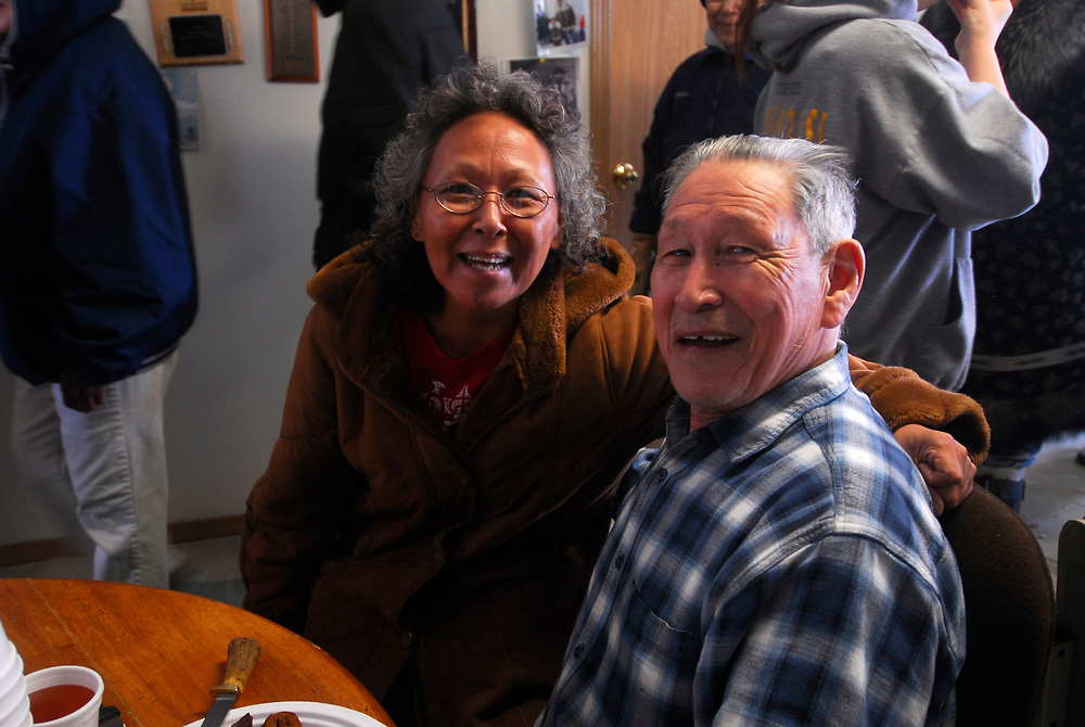 "Barrow, Alaska. After David Leavitt's Crew got a 34ft7"" whale, the crew serves on the feast at the captain's house. This whale was the fourth landed whale of this Spring season. In the photo is Fannie Akppik and David Leavitt. May 2nd 2007."