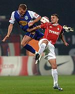 n/z.: Maciej Scherfchen (nr13-Lech), Pawel Brozek (nr23-Wisla) podczas meczu ligowego Wisla Krakow (czerwone-biale) - Lech Poznan (niebieskie) 5:1 , I liga polska , 8 kolejka sezon 2005/2006 , pilka nozna , Polska , Warszawa , 24-09-2005 , fot.: Adam Nurkiewicz / mediasport..Maciej Scherfchen (nr13-Lech), Pawel Brozek (nr23-Wisla)  fight for the ball during Polish league first division soccer match in Cracow. September 24, 2005 ; Wisla Cracow (red-white) - Lech Poznan (blue) 5:1 ; 8 round season 2005/2006 , football , Poland , Cracow ( Photo by Adam Nurkiewicz / mediasport )