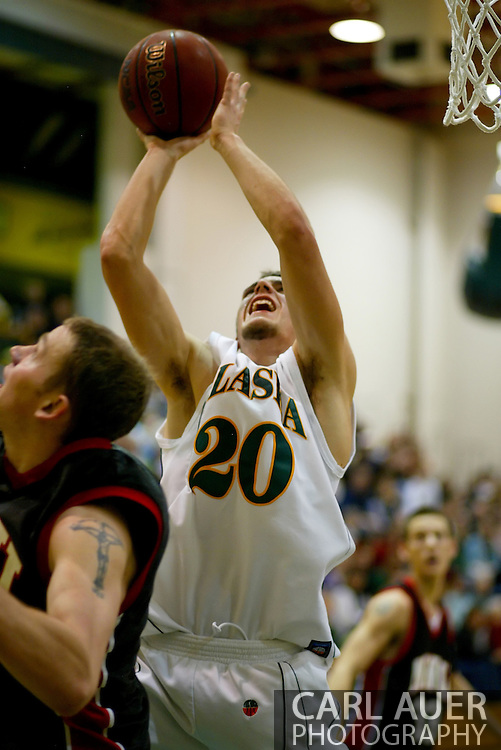 1/13/2006: Casey Fisher of the Northwest Nazarene University Crusaders fouls Freshman guard Trenton Millar (20) of the UAA Seawolves as he heads to the hoop in the Alaska Anchorage comeback victory over Northwest Nazarene, 60-57, in men?s basketball action at the Wells Fargo Sports Complex on Saturday.