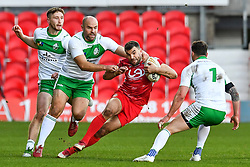 11th November 2018 , Racecourse Ground,  Wrexham, Wales ;  Rugby League World Cup Qualifier,Wales v Ireland ; Elliot Kear of Wales is tackled by Liam Finn of Ireland <br /> <br /> <br /> Credit:   Craig Thomas/Replay Images