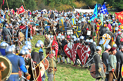 © Licensed to London News Pictures. 13/10/2018<br /> BATTLE, UK.<br /> Saxon warriors at the battle (left) facing Norman army (right)<br /> English Heritage Battle of Hastings re-enactment at Battle Abbey,Battle, on the 1066 battle field.<br /> Photo credit: Grant Falvey/LNP