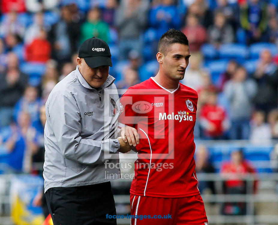 Russell Slade and Federico Macheda of Cardiff City during the Sky Bet Championship match at the Cardiff City Stadium, Cardiff<br /> Picture by Mike  Griffiths/Focus Images Ltd +44 7766 223933<br /> 18/10/2014