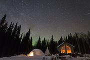 Northern lights and stars light up the sky at Kenji Yoshikawa's reindeer farm outside Fairbanks, Alaska, USA