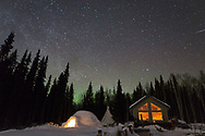 Northern lights and stars light up the sky at Kenji Yoshikawa's reindeer farm outside Fairbanks, Alaska, USA