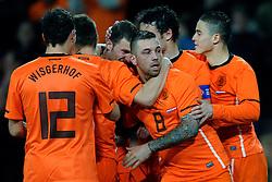 09-02-2011 VOETBAL: NEDERLAND - OOSTENRIJK: EINDHOVEN<br /> Netherlands in a friendly match with Austria won 3-1 / Klaas-Jan Huntelaar NED took his tenth goal in his last six games for 2-0 and celebrate this with Theo Janssen 8, Ibrahim Afellay, Erik Pieters and Mark van Bommel<br /> ©2011-WWW.FOTOHOOGENDOORN.NL