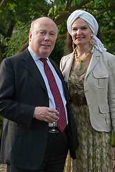 © licensed to London News Pictures. London, UK 13/06/2012. Julian Fellows and his wife Emma Joy Kitchener enjoying The Haven's annual fundraising garden party at the Chelsea Physic Garden hoping to raise over £40,00 to help support people with breast cancer. Photo credit: Tolga Akmen/LNP
