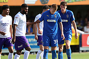 AFC Wimbledon defender Ryan Delaney (21) talking to AFC Wimbledon striker Joe Pigott (39) prior to corner during the EFL Sky Bet League 1 match between AFC Wimbledon and Shrewsbury Town at the Cherry Red Records Stadium, Kingston, England on 14 September 2019.