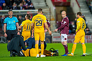 Steven Naismith (#14) of Heart of Midlothian FC points to Marvin Bartley (#6) of Livingston FC after they clash heads during the Ladbrokes Scottish Premiership match between Heart of Midlothian FC and Livingston FC at Tynecastle Park, Edinburgh, Scotland on 4 December 2019.