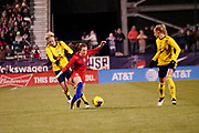 USA midfielder Rose Lavelle (16) gets taken down by a Swedish defender during an international friendly women's soccer match, Thursday, Nov. 7, 2019, in Columbus, Ohio. USA defeated Sweden 3-2 . (Jason Whitman/Image of Sport)