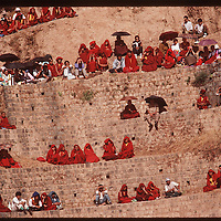 Photo by David Stephenson. Tibetan monks and other spectators watch festivities at annual Tibetan Children Village celebration in Dharamsala, India, in 11/91.