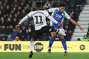 Derby County midfielder Florian Jozefzoon challenges Wigan Athletic midfielder Reece James for the ball during the EFL Sky Bet Championship match between Derby County and Wigan Athletic at the Pride Park, Derby, England on 5 March 2019.
