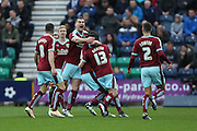 Joey Barton of Burnley is mobbed by his team mates after scoring the first goal of the game to make it 1-0 during the Sky Bet Championship match between Preston North End and Burnley at Deepdale, Preston, England on 22 April 2016. Photo by Simon Brady.