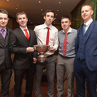 Barry Keating, Paul Keating,Chris O'Looney, Cathal McConigley and Alan Mullins members of the Inagh/Kilnamona Junior A winning team receiving their medals on the night