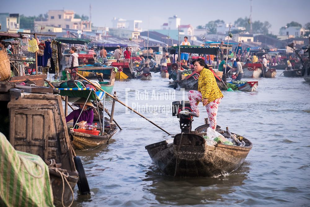 Morning activity at Cai Rang Floating Market on the Can Tho River. The market is used by wholesalers to sell to market sellers, who then sell directly to customers.