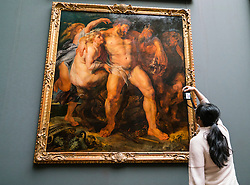 """Woman photographing painting """"The Drunken Hercules being Led by a Nymph"""" by Peter Paul Rubens at Gemäldegalerie Alte Meister or Zwinger Museum in Dresden, Germany .Editorial Use Only."""