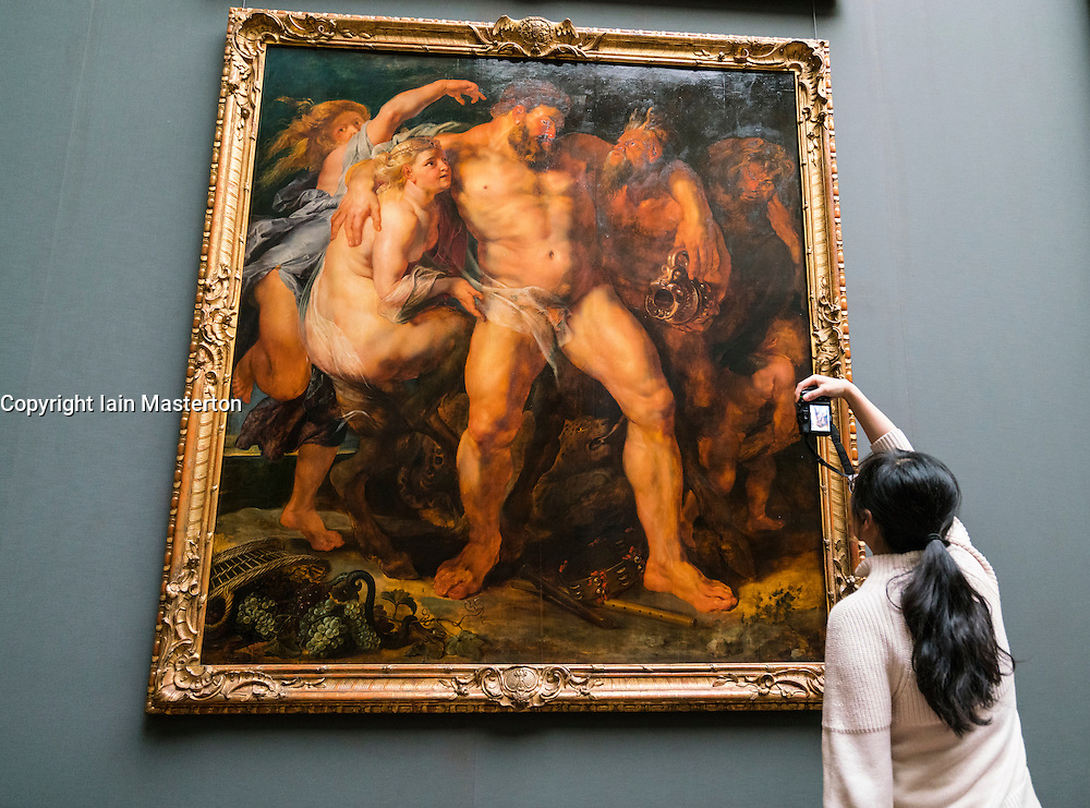 "Woman photographing painting ""The Drunken Hercules being Led by a Nymph"" by Peter Paul Rubens at Gemäldegalerie Alte Meister or Zwinger Museum in Dresden, Germany .Editorial Use Only."
