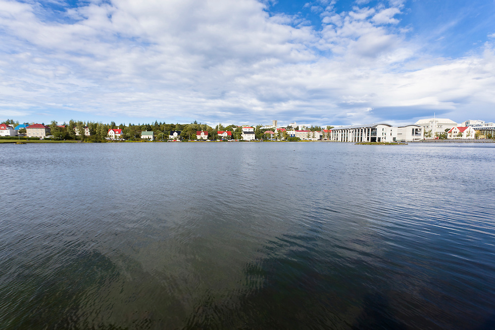 Tjornin on a summer day with Reykjavik City Hall in the back