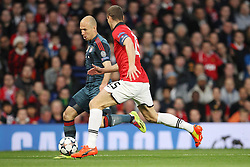 01.04.2014, Old Trafford, Manchester, ENG, UEFA CL, Manchester United vs FC Bayern Muenchen, Viertelfinale, Hinspiel, im Bild l-r: im Zweikampf, Aktion, mit Arjen Robben #10 (FC Bayern Muenchen) und Nemanja Vidic #15 (Manchester United) // during the UEFA Champions League Round of 8, 1nd Leg match between Manchester United and FC Bayern Muenchen at the Old Trafford in Manchester, Great Britain on 2014/04/01. EXPA Pictures © 2014, PhotoCredit: EXPA/ Eibner-Pressefoto/ Kolbert<br /> <br /> *****ATTENTION - OUT of GER*****