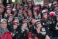 The members of the Sardis Drum band gather around the Town Plaza bobsled for a portrait during the 2010 Olympic Winter Games in Whistler, BC