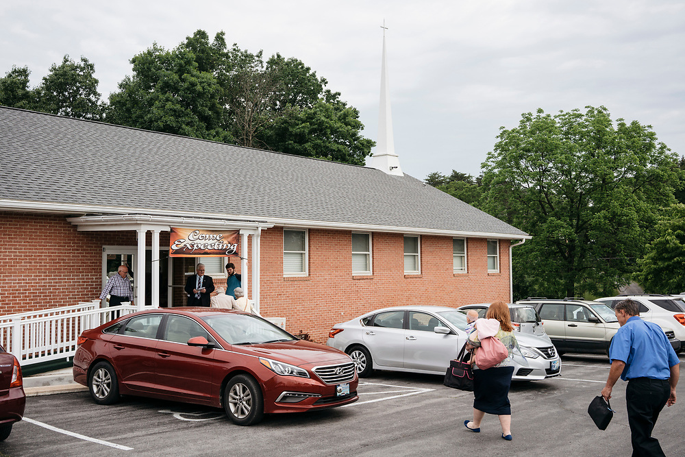 Church-goers are welcomed as they enter the Full Gospel Pentecostal Church in Martinsburg, WV on June 4, 2017.