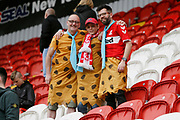 Middlesbrough fans in caveman fancy dress during the EFL Sky Bet Championship match between Rotherham United and Middlesbrough at the AESSEAL New York Stadium, Rotherham, England on 5 May 2019.