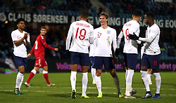 England U21's Dominic Calvert-Lewin celebrates scoring his side's fifth goal of the game from the penalty spot with team-mates during the international friendly match at the Blue Water Arena, Esbjerg.