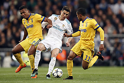 (l-r) Alex Sandro of Juventus FC, Cristiano Ronaldo of Real Madrid, Douglas Costa of Juventus FC during the UEFA Champions League quarter final match between Real Madrid and Juventus FC at the Santiago Bernabeu stadium on April 11, 2018 in Madrid, Spain