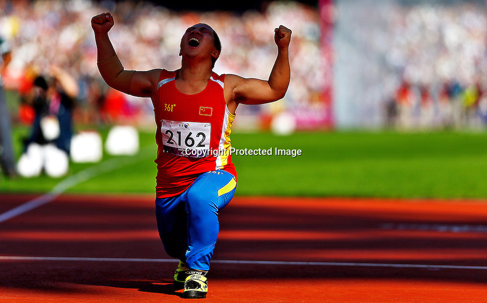 Zhiming Wang of China celebrates after winning gold medal in Men's Javelin Throw F40 final at Olympic Stadium during the London 2012 Paralympic Games, London, Britain, 07 September 2012.  EPA/KERIM OKTEN