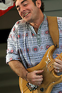 James Dean Conklin performs with Solar Punch at the Sounds of Peace concert on the porch of Susan Rutman in 2011.
