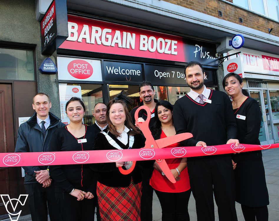 Pictured is Jeanne Douglas, Mayor of Melton, centre, cutting the ribbon to open Melton Mowbray Post Office, with from left, Robert Darrant (the landlord), Mandeep Kavr, Harry Singh, Parmjit Singh, Mandy Kavr, postmaster Amarjit Singh, Parmjit Kavr<br /> <br /> The Mayor of Melton Jeanne Douglas has officially opened the new Post Office in Melton Mowbray.<br /> <br /> Date: March 16, 2016