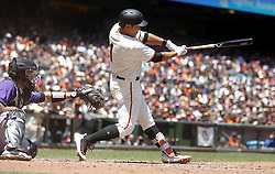 June 28, 2017 - San Francisco, CA, USA - The San Francisco Giants' Jae-Gyun Hwang hits an RBI ground out during the fourth inning against the Colorado Rockies on Wednesday, June 28, 2017, at AT&T Park in San Francisco. The Giants won, 5-3. (Credit Image: © Aric Crabb/TNS via ZUMA Wire)