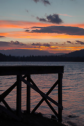 """Donner Lake Sunrise 8"" - Photograph taken at sunrise of a pier silhouette along the shore of Donner Lake in Truckee, California."