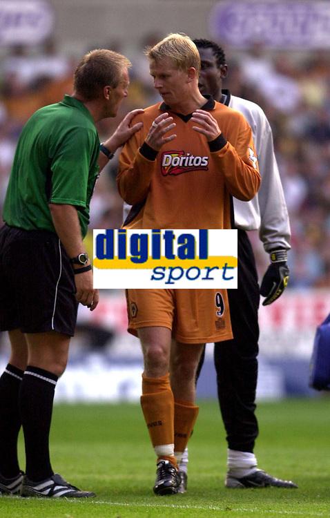 Photo: Greig Cowie.<br /> 08/08/2003.<br /> Pre-Season Football Friendly. Wolverhampton Wanderers v Boavista.<br /> Steffen Iversen has a word with ref Graham Poll