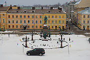 HELSINKI, FINLAND - FEBRUARY 14, 2013: View to the central square of the city with Alexander II monument in Helsinki, Finland.