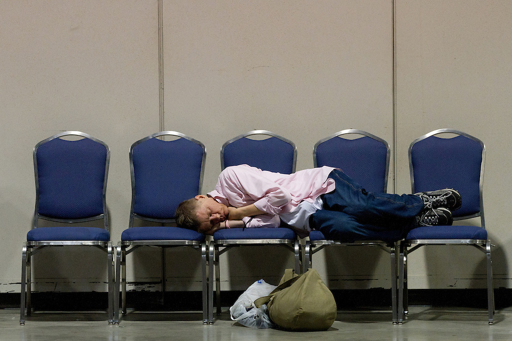 An unidentified man sleeps while taking shelter in the Springfield Civic Center in downtown Springfield, MA where a tornado struck on Wednesday afternoon June 1, 2011. The city opened the center to residents who were victimized by the storm.  (Matthew Cavanaugh for The Boston Globe)