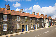 Small row of terraced houses faced with flint, Thetford, Norfolk, England