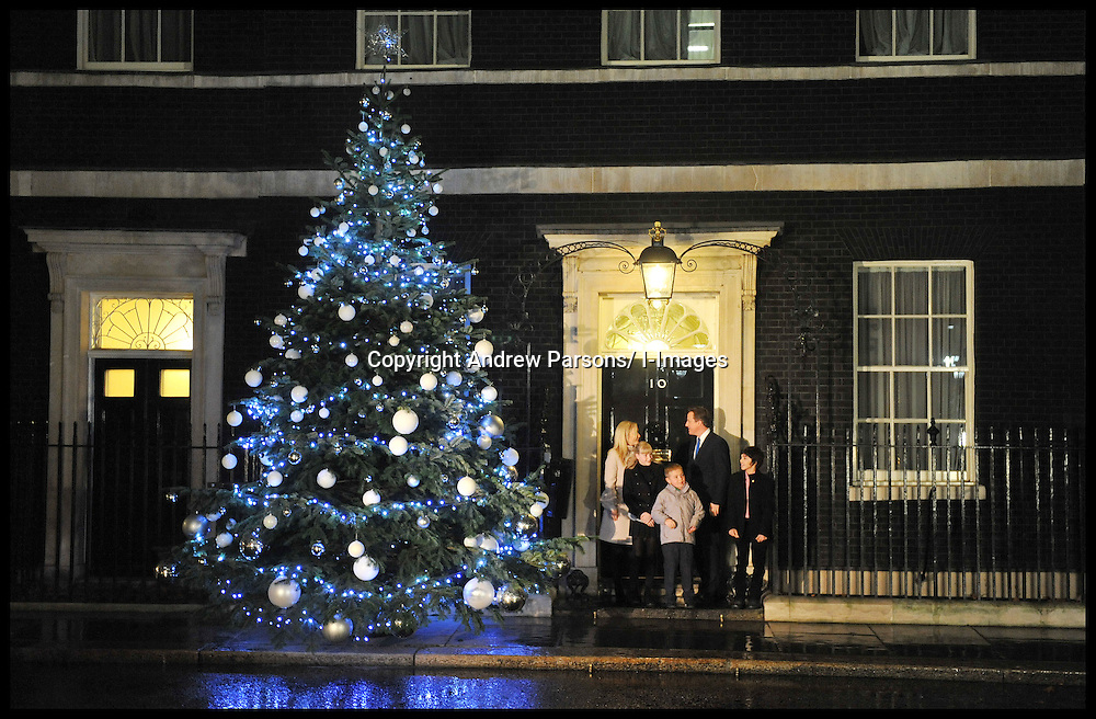 The Prime Minister David Cameron switiches on  the Christmas Tree lights at No10 Downing Street with Blue Peter Presenter Helen Skelton and children that have won Gold Blue Peter Badges, Thursday December 1, 2011 Photo by Andrew Parsons/ i-Images