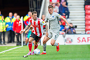 Chris Maguire (#7) of Sunderland AFC shields the ball from Paul Downing (#5) of Portsmouth FC during the EFL Sky Bet League 1 match between Sunderland and Portsmouth at the Stadium Of Light, Sunderland, England on 17 August 2019.