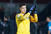 Macclesfield Town goalkeeper Owen Evans applauds the fans after the EFL Sky Bet League 2 match between Salford City and Macclesfield Town at the Peninsula Stadium, Salford, United Kingdom on 23 November 2019.