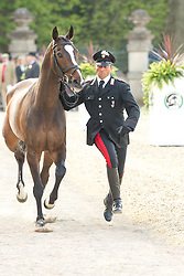 Stefano Brecciaroli (ITA) leads Apollo VD Wendi Kurt Hoeve for the vet's inspection during the trot up at the 2013 Mitsubishi Motors Badminton Horse Trials. Thursday 02  May  2013.  Badminton, Gloucs, UK..Photo by: Mark Chappell / i-Images