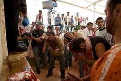 After marching through Nabatieh Ashura celebrators clean the blood from their heads..