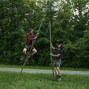 Pittsboro, NC - May 12: Noel and Grey play with bamboo poles (used as supports for crops), using them to pole vault and climb at the farm at Circle Acres. (Photo by Logan Mock-Bunting)
