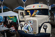 An old bus from Argentina which had driven to Rio and was now parked at the site set up for football fans who had nowhere to stay but the tents, campervans, cars and caravans that they had bought with them. The site, at the Terreirao Do Samba, Rio de Janeiro, Brazil, was arranged by the city government once they realised the number of fans in this situation was significant and rather than having them scattered about the sity they offered secure, enclosed accommodation with sanitation and water. The majority of fans at the site were Argentinian but there were also people from Chile, USA, Uruguay and Colombia. Photo by Andrew Tobin/Tobinators Ltd
