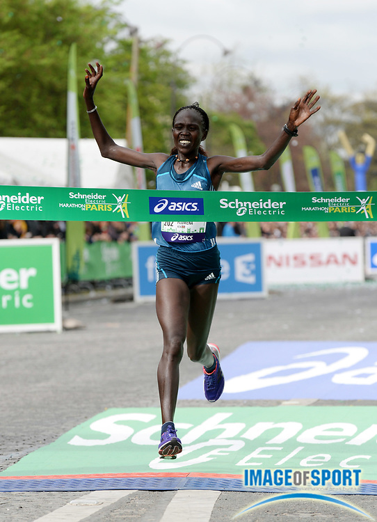 Apr 6, 2014; Paris, France; Flomena Cheyech (KEN) wins the womens race in the Schneider Electric Marathon de Paris in 2:22:40. Photo by Jiro Mochizuki