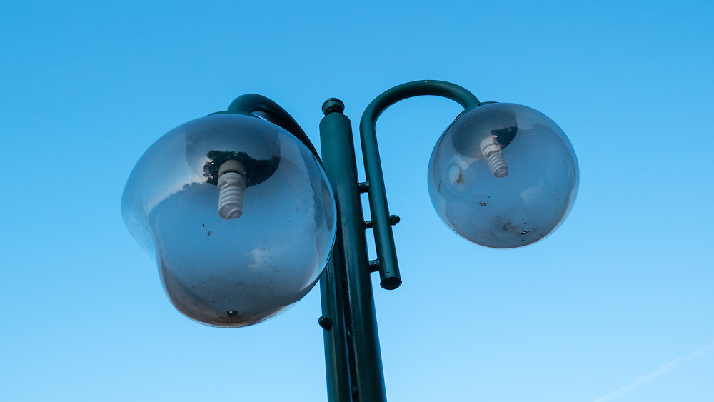 Street lamps semi-melted by the heat of wild fires.