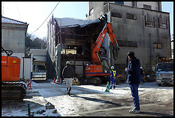 Construction workers tear down an old brewery which was hit by the Tsunami in the city of Shiogama, Miyagi. The Town was hit by the Tsunami, Saturday February 4, 2012. Photo By Andrew Parsons/i-Images