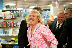 "Leigh Francis in character as TV JUICE host Keith Lemon leaves WHSmith in Meadowhall shopping centre in Sheffield after hi successful signing event for . 'Keith Lemon: The Rules""  The event originally scheduled for 5:00 - 5:30 was so popular that Keith started signing early and didn't finish until 7:05pm despite sales of the book being restricted.  .1st November 2011. Image © Paul David Drabble"