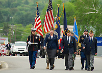Members of the Veteran's of Foreign Wars Post 1670 and American Legion Post 1 march towards Veteran's Square during Laconia's Memorial Day parade on Monday morning.   (Karen Bobotas/for the Laconia Daily Sun)