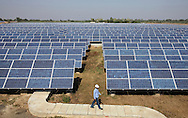 Solar panels at Azure Solar Plant in Khadoda in Gujarat state in India on Dec 15, 2011.<br /> India plans to generate 1,000 MW of power by 2013 as the county, with growing economy with a surging middle class, is facing a severe electricity deficit that often runs between 10 and 13 percent of daily need.<br /> (Photo by Kuni Takahashi)