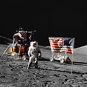 Harrison H Schmitt, pilot of the lunar module, stands on the lunar surface near the United States flag during  NASA's final lunar landing mission in the Apollo series 13 December 1972.  Credit: NASA.  Science Astronaut  Space Travel